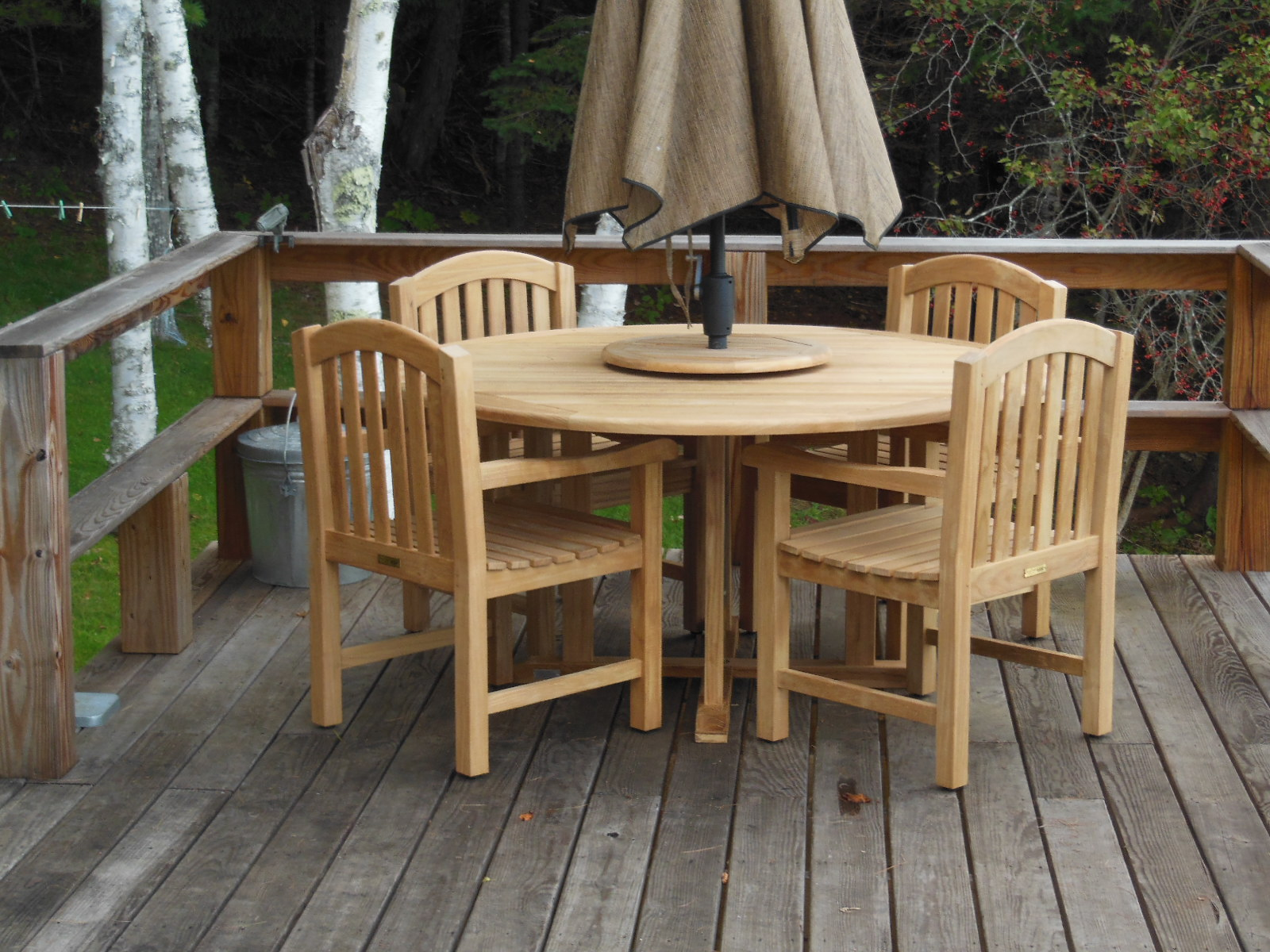Goldenteak's Padua Round Teak Table 48in and 4 Aquinah Chairs with Arms (RACH04), private residence