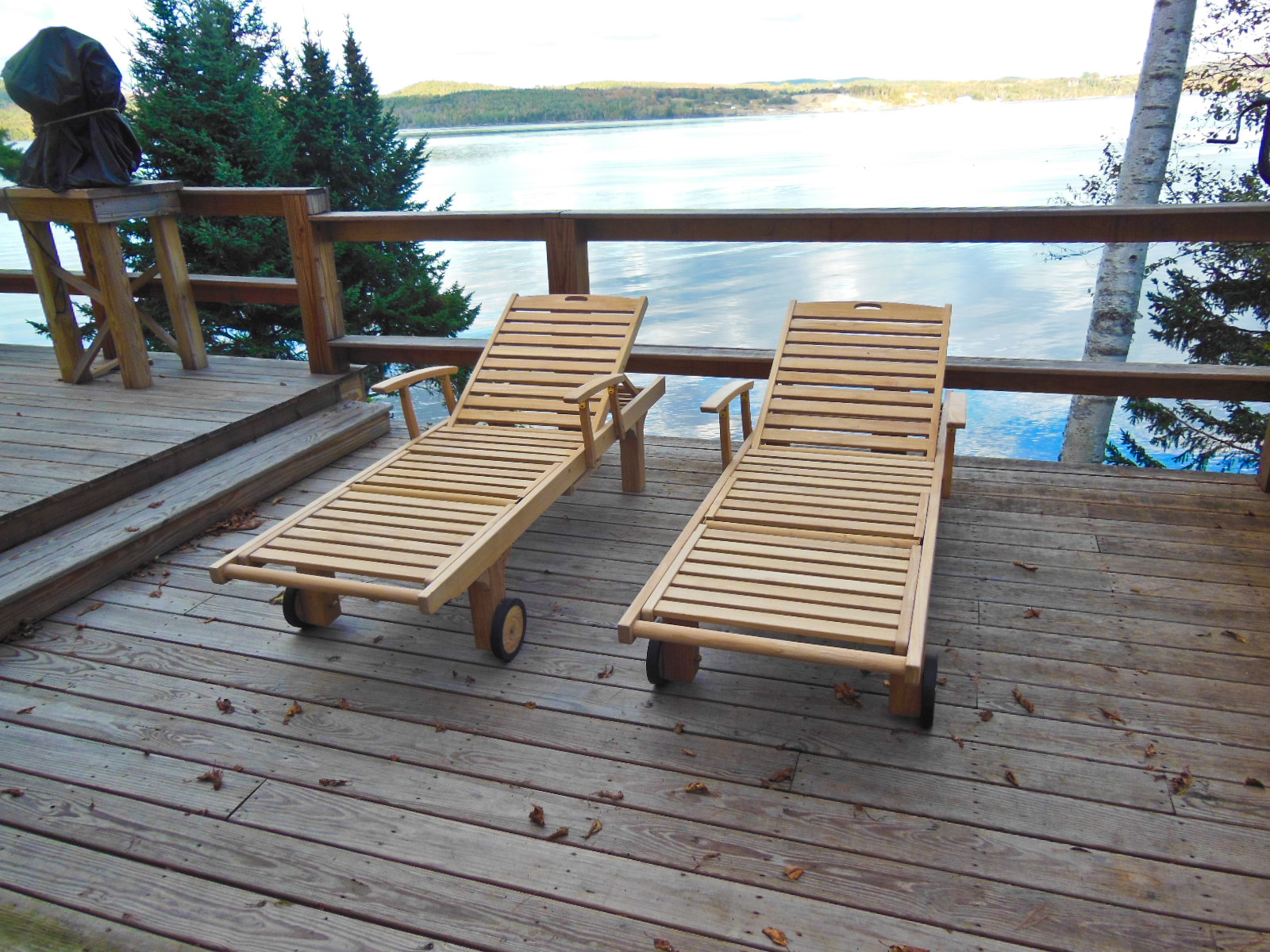 Goldenteak's Teak Teak Chaise Lounger with arms and tray (SLT-2-A) in peaceful Calais Maine