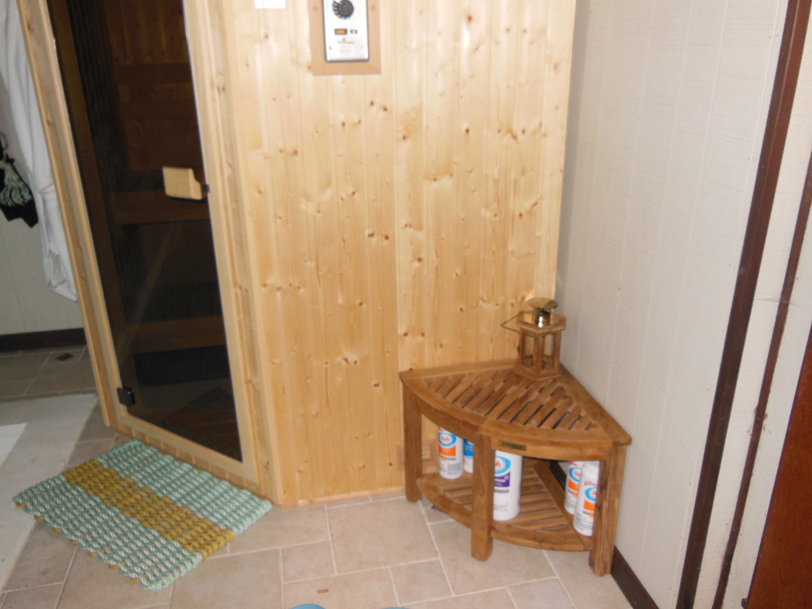 Goldenteak's Teak Corner Table or Shower Stool (TSCT9) in use