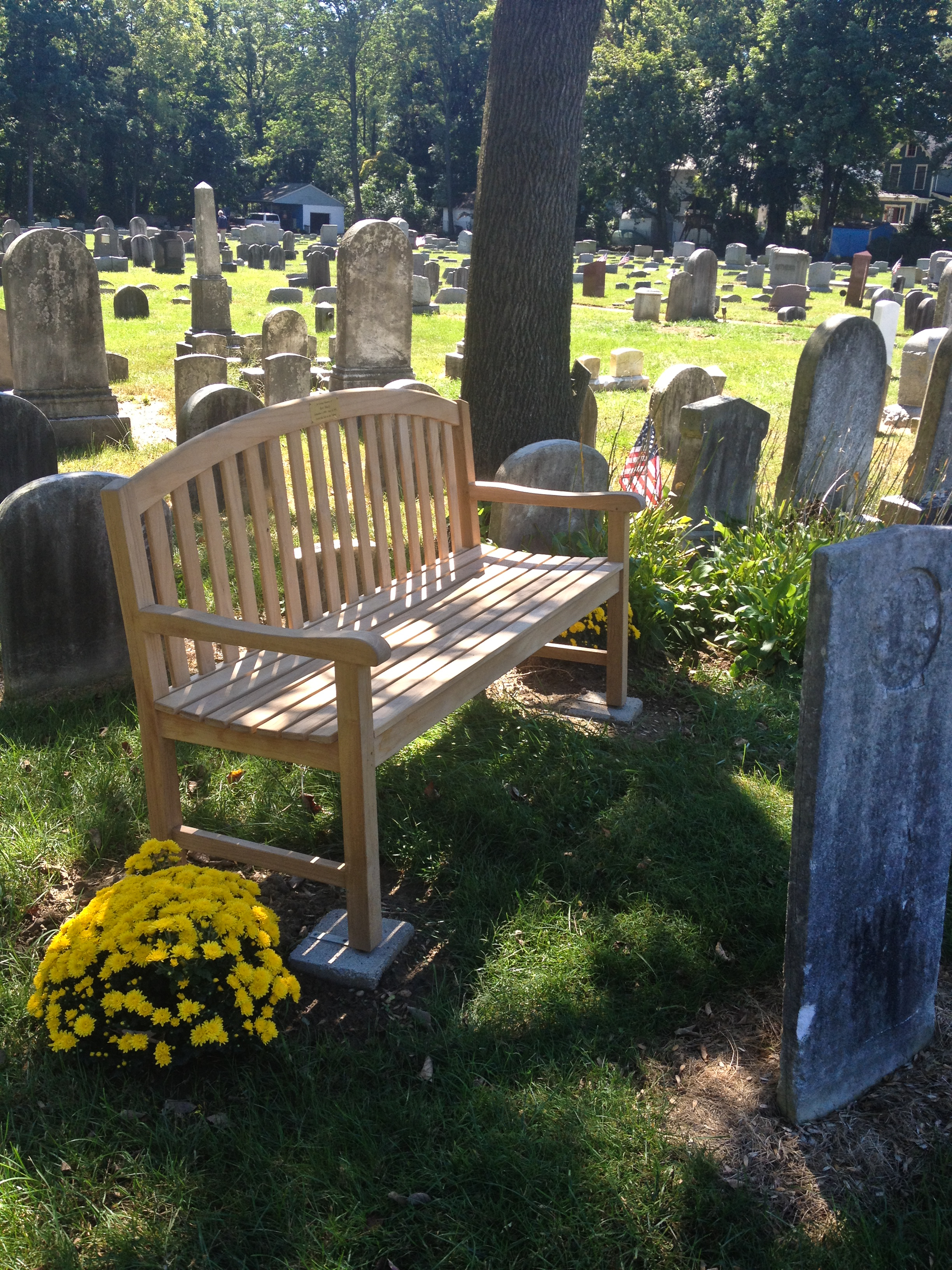 Goldenteak's Teak 5 ft Aquinah Bench at the Baptist Cemetery in Haddonfield, NJ