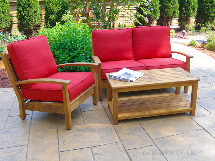 Goldenteak's Teak Deep Seating Club Chair and Loveseat in Jockey red, with our Teak Coffee Table!