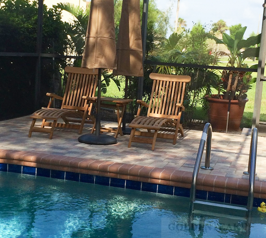 Goldenteak's Teak Steamer Chairs around a pool - relaxing!