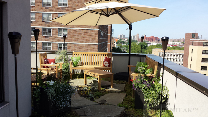 Goldenteak's Teak Bench, Teak Chairs and Coffee Table on a NYC Roof Deck