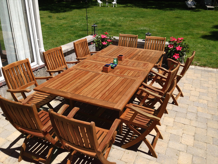 Goldenteak Teak Extension Table 81L and 10 Teak Providence Chairs at customer house