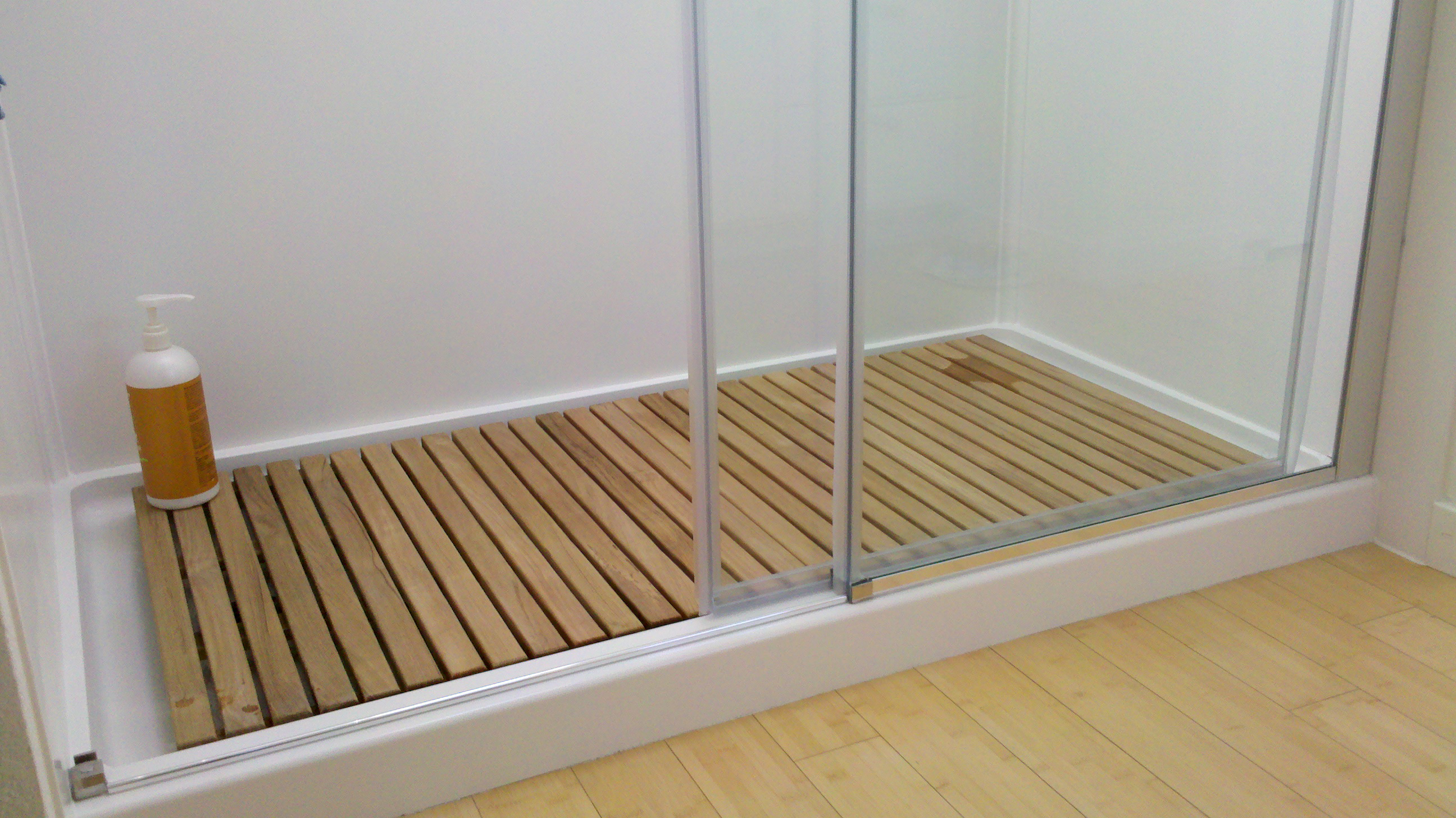 Goldenteak's Teak Bath Mat in use inside a shower