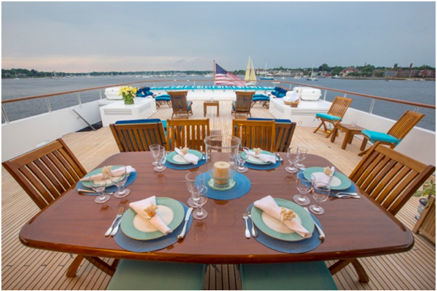 Goldenteak Teak Patio Furniture, Folding Rockport Chairs (84, 86) and Chaise Lounge Steamer chairs (38N)on the magnificent Capricorn Yacht