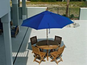 Goldenteak Teak Round Dining Table with Teak Folding Chairs - Photo