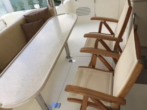 Teak And Sling Recliner Chair on Boat Ruthless - Goldenteak Customer Photo