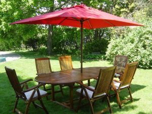 Teak Dining Set with Oval Extension Table and Reclining Chairs - Photo