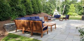 Goldenteak Deep Seating Sectionals and Club Chairs on Patio